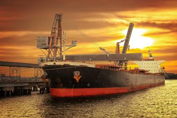 Big ship under loading coal in Port of Gdansk, Poland.
