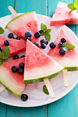 Fresh watermelon popsicles with blueberries