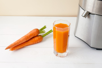 fresh carrot juice with juicer