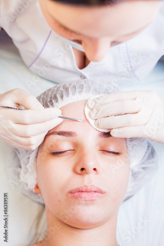 Cosmetologist at spa beauty salon doing acne treatment for Acne salon treatments