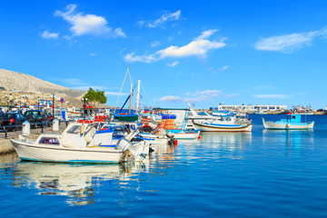 Colorful boats over clear water in peaceful Greek bay, Greece