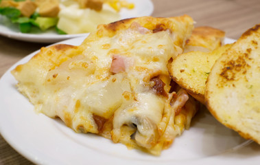 Closeup view of an appetising ham and pineapple Italian pizza wi