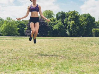 Woman skipping in the park