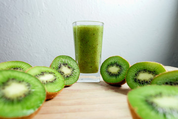 kiwi smoothie tropical fresh blended on wood table