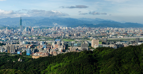 Taipei City / A panoramic view of Taipei City with Taipei 101. As seen from the Bi Shan Yan Temple during the early morning hours. High resolution picture can be easily cropped to suit.