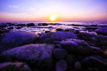 Amazing sunset on the pebble beach
