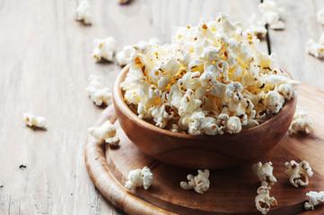 Salt popcorn on the wooden table