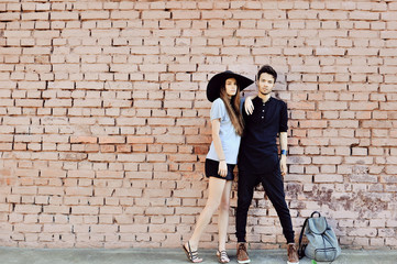 Young couple in love outdoor - full length portrait