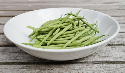 Plate of French green beans freshly picked from the vegetable garden