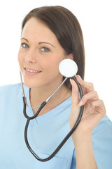 Portrait Of A Beautiful Young Female Doctor Holding A Stethoscope