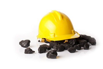 heap of coal and protective helmet