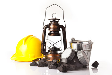 Mining tools with with ear muffs and oil lantern
