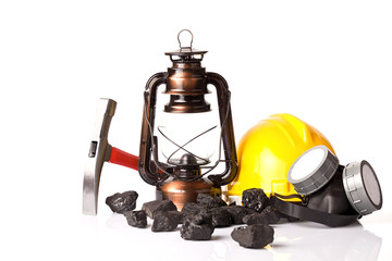 Mining tools with protective helmet, ear muffs,pickaxe and oil lantern