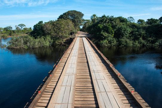 Wooden bridge in the wet lands of Pantanal, Brazil
