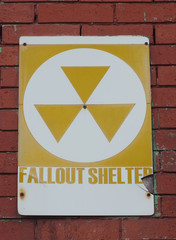 Old Fallout Shelter Sign on Brick Wall