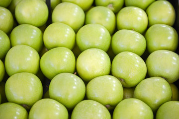 neatly folded green apples