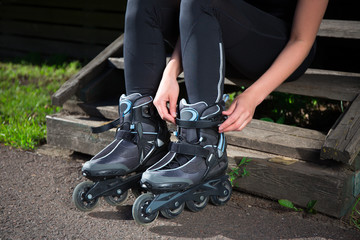close up of roller skates on female legs