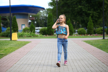 School girl calling by phone