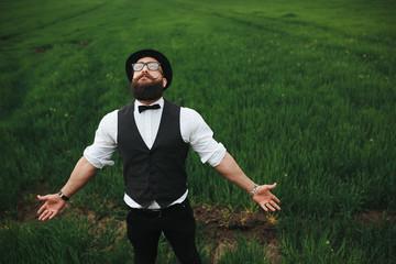 man with a beard walking on the field