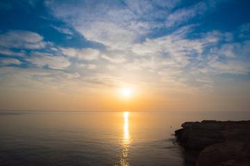 Rocky sea shore on the beautiful sunrise