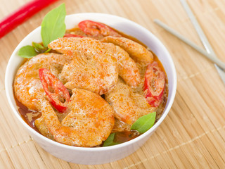 Thai Prawn Curry - King prawns in red curry sauce and coconut milk in a lilac bowl.