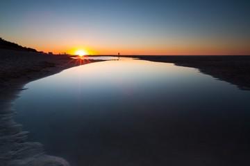 Beautiful Baltic sea beach at sunset