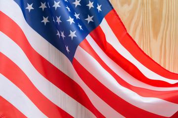 independence day 4 JULY america flag on wood background Filtered image processed vintage effect.