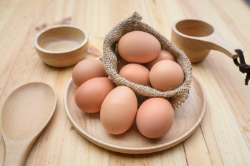 eggs on plate wood background