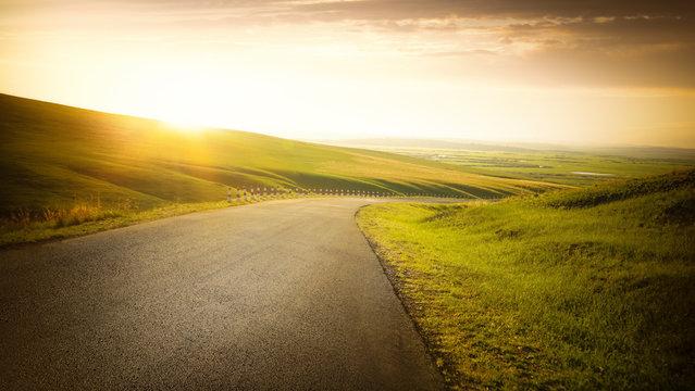 Empty asphalt road on grassland