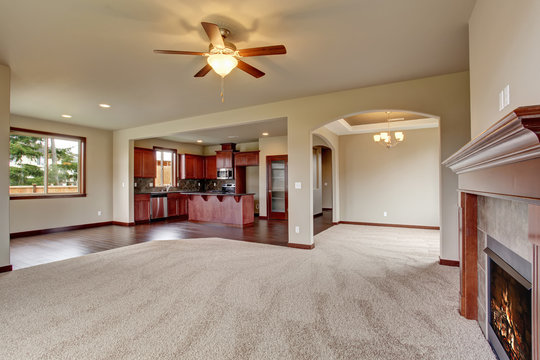 Lovely unfurnished living room with carpet.