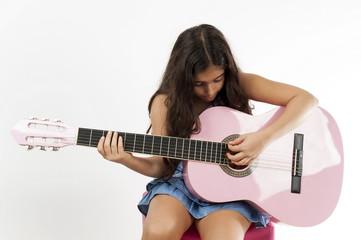 Girl playing guitar and sing
