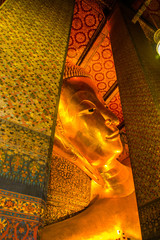 The Reclining Buddha (Phra Buddhasaiyas) at Wat Pho or Wat Phra Chettuphon Wimon Mangkhlaram Ratchaworamahawihan, Bangkok, Thailand,golden statue.