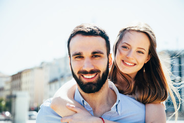 Young loving couple at the park in summer while embracing