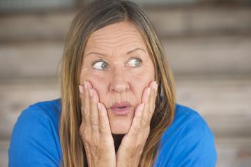 Shocked fearful woman portrait