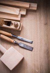 Group of wooden joiner's working tools on wood board close up