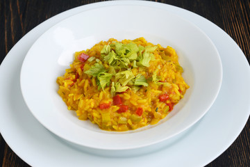 Pumpkin risotto on the wooden table