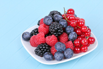Assortment of berries on white plate