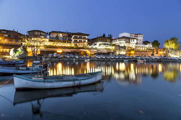Fishing boats in costal city at night