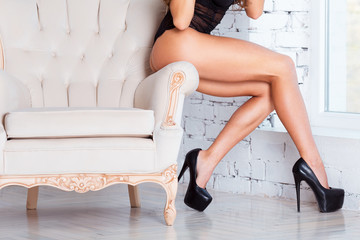 Perfect, sexy legs and ass of young woman wearing seductive