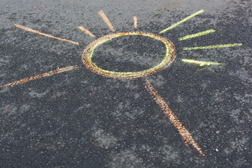 sun drawing on asphalt
