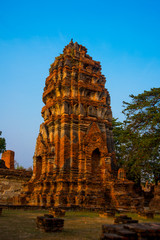 Ancient palaces on the background at sunset. Ayutthaya Thailand.