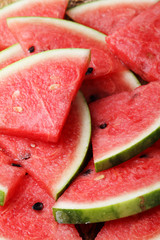 Slice of fresh watermelon on wooden plate