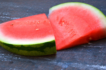 watermelon slices lie on a board