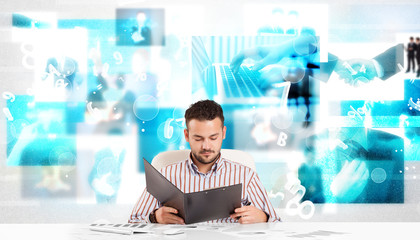 Business person at desk with modern tech images at background