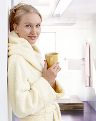 Attractive young woman with morning tea