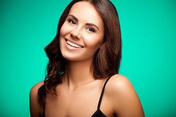 beautiful cheerful smiling woman, over bright green