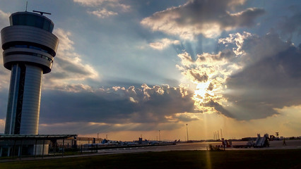 Airport traffic control tower at dramatic sunset in Sofia, Bulgaria