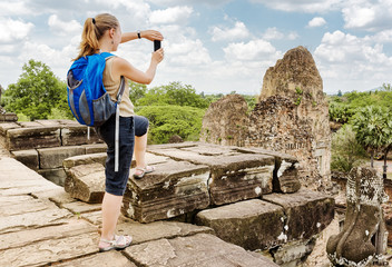 Tourist taking picture of the ruins Pre Rup, Angkor, Cambodia