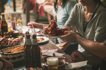 Closeup of crab served on table with people in background