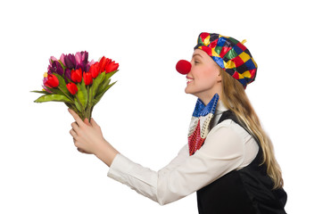 Pretty female clown with flowers isolated on white